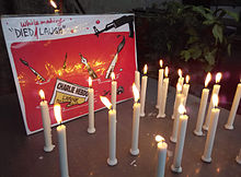 """Indian journalists expressed solidarity with the victims of attack at New Delhi on 9 January 2015. Displayed cartoon by Shekhar Gurera Main article: Charlie Hebdo shooting On 7 January 2015, two Islamist gunmen[50] forced their way into and opened fire in the Paris headquarters of Charlie Hebdo, killing twelve: staff cartoonists Charb, Cabu, Honoré, Tignous and Wolinski,[51] economist Bernard Maris, editors Elsa Cayat and Mustapha Ourrad, guest Michel Renaud, maintenance worker Frédéric Boisseau and police officers Brinsolaro and Merabet, and wounding eleven, four of them seriously.[52][53][54][55][56][57] During the attack, the gunmen shouted """"Allahu akbar"""" (""""God is great"""" in Arabic) and also """"the Prophet is avenged"""".[50][58] President François Hollande described it as a """"terrorist attack of the most extreme barbarity"""".[59] The two gunmen were identified as Saïd Kouachi and Chérif Kouachi, French Muslim brothers of Algerian descent.[60][61][62][63] The """"survivors' issue"""" Main article: Charlie Hebdo issue No. 1178 The day after the attack, the remaining staff of Charlie Hebdo announced that publication would continue, with the following week's edition of the newspaper to be published according to the usual schedule with a print run of one million copies, up significantly from its usual 60,000.[64][65] On 13 January 2015 the news came on BBC that the first issue after the massacre will come out in three million copies.[66] On Wednesday itself it was announced that due to a huge demand in France, the print run would be raised from three to five million copies.[67] The newspaper announced the revenue from the issue would go towards the families of the victims.[68] The French government granted nearly €1 million to support the magazine.[69] The Digital Innovation Press Fund (French: Fonds Google–AIPG pour l'Innovation Numérique de la presse), partially funded by Google, donated €250,000,[70] matching a donation by the French Press and Pluralism Fund.[71] The Guardian Me"""